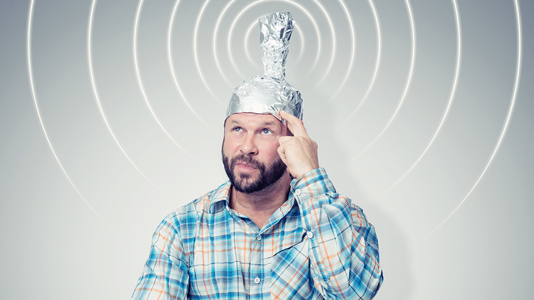 Man wearing a tinfoil hat, getting a signal!