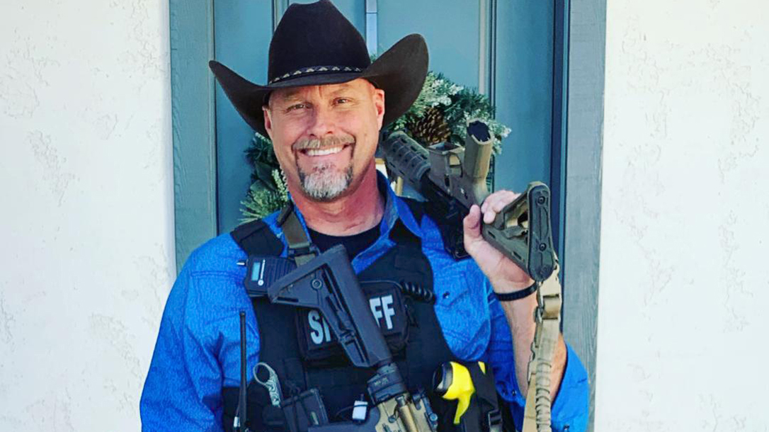 Sheriff Mark Lamb smiling with a rifle in Queen Creek, AZ.