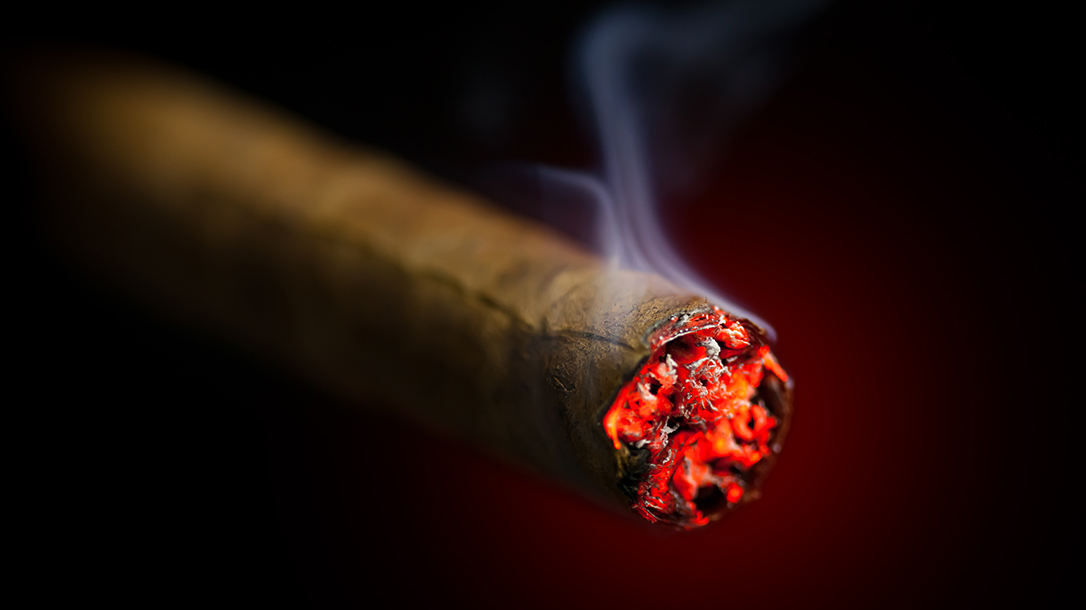Burning a cigar is the perfect ending to a busy day.