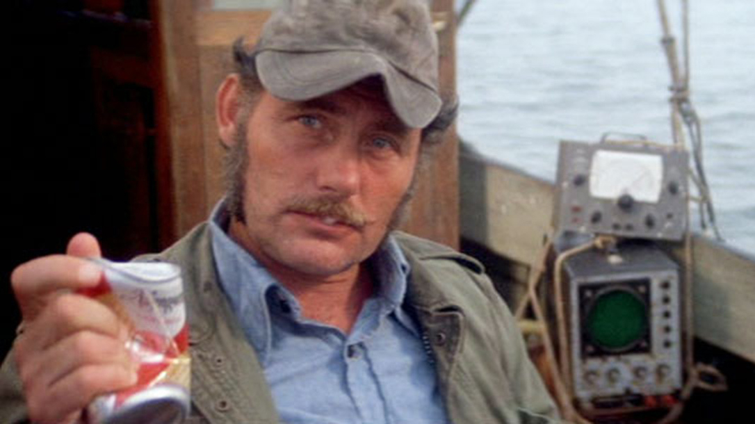 Crushing a beer is a sign of strength, demonstrated by Quint in Jaws!