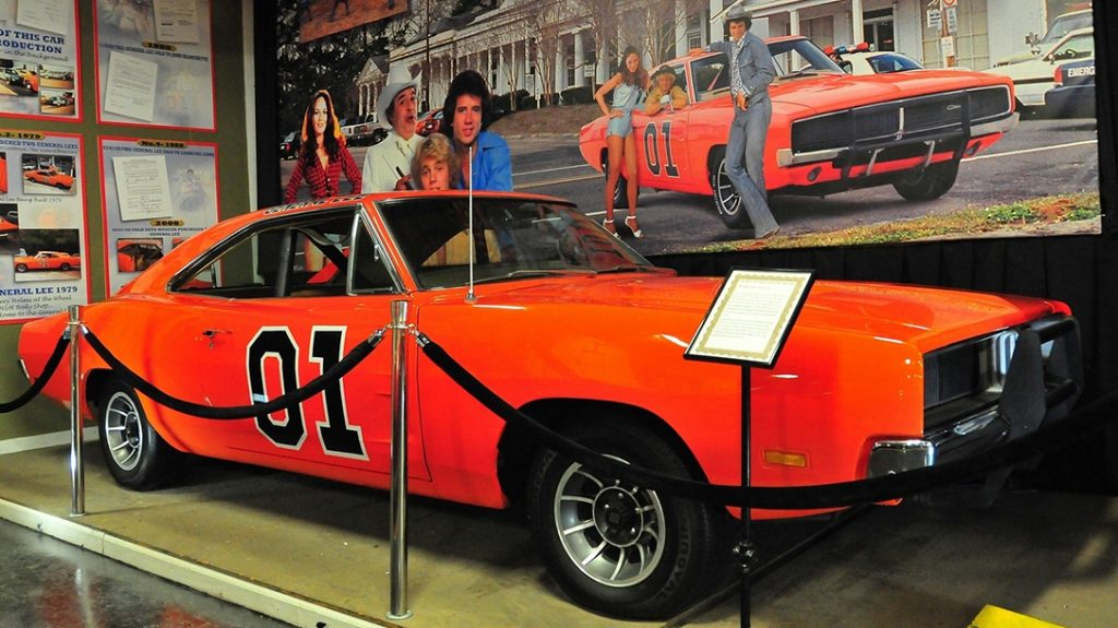 Bo, Luke and Daisy Duke in front of the 1969 Dodge Charger classic!