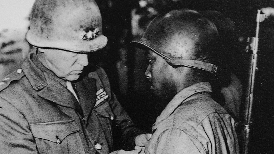 General Patton awards a medal to a soldier in the 761st.