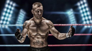 Mixed martial artist posing in the ring against spotlights. Concept of mma, ufc, thai boxing, classic boxing.