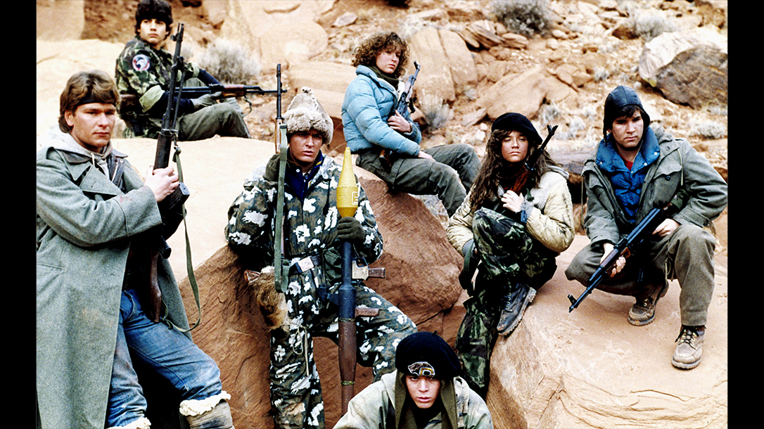 The cast of Red Dawn stands poised ready for battle.