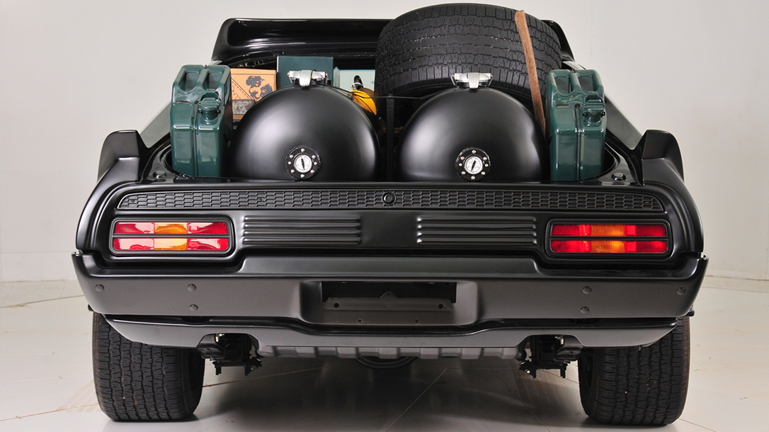 """It had had a full trunk and rear window (for you purists, that's """"boot"""" and """"backlight""""), which they removed for more of a survival elan, with two enormous cylindrical fuel tanks, a spare wheel and the like."""