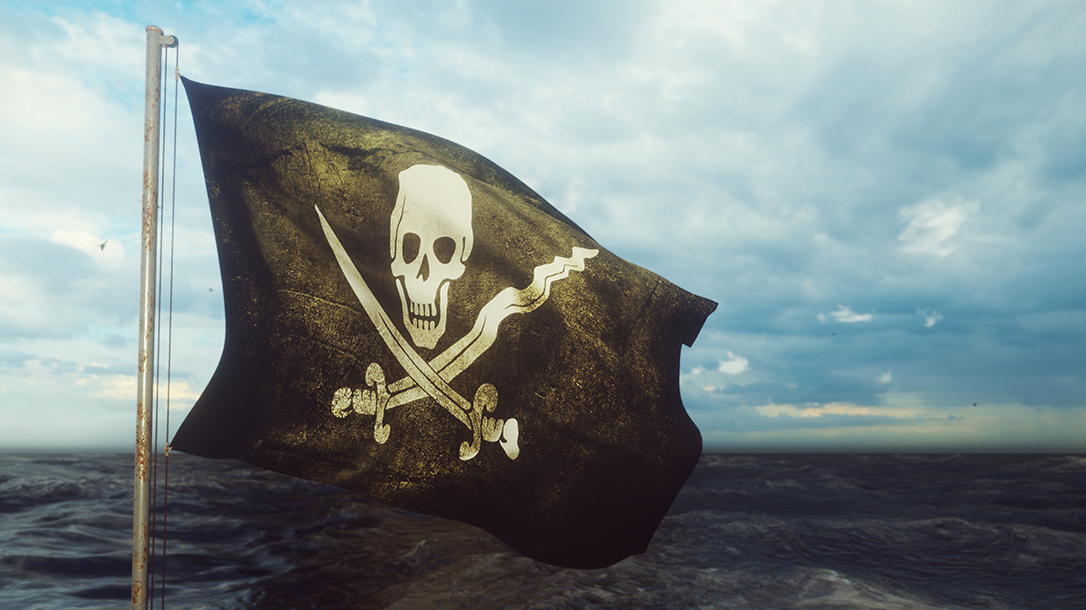 Real life pirates with their Jolly Roger flag!