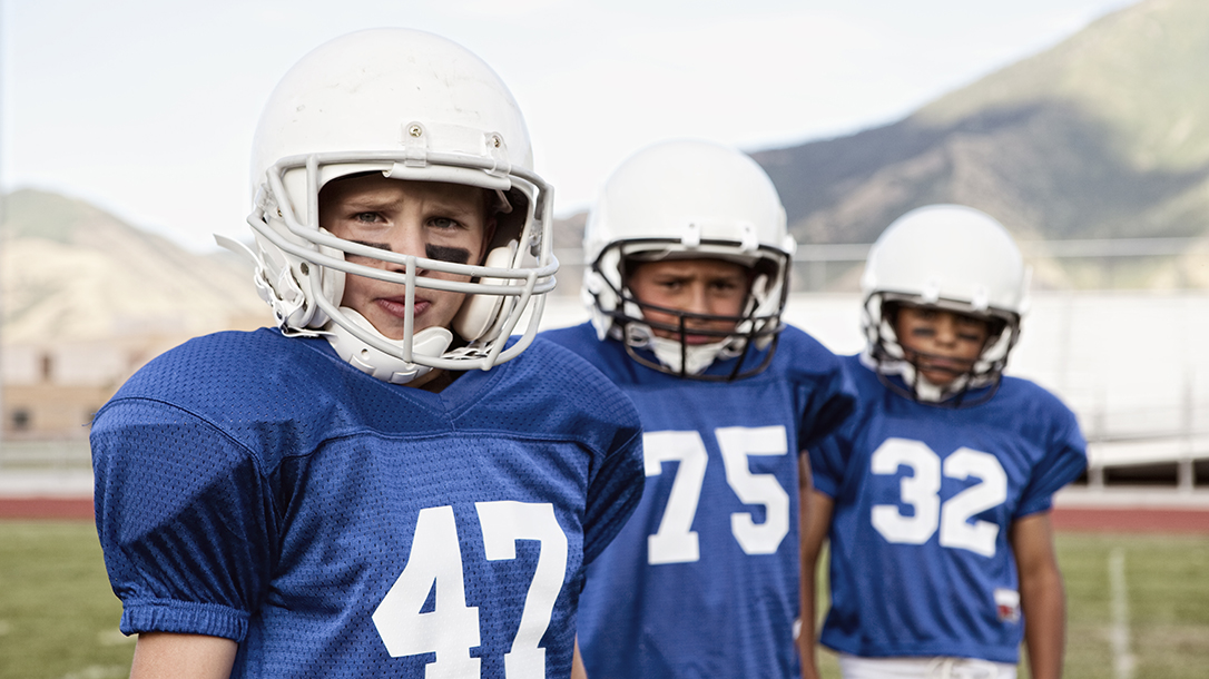 Football players on the field, training to be the best in youth sports!